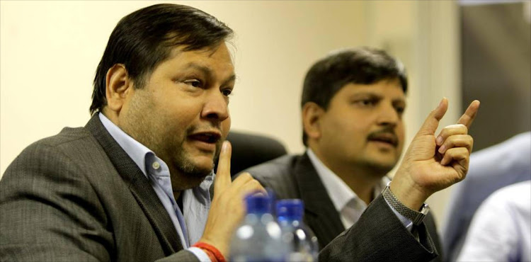Businessmen Ajay and Atul Gupta.