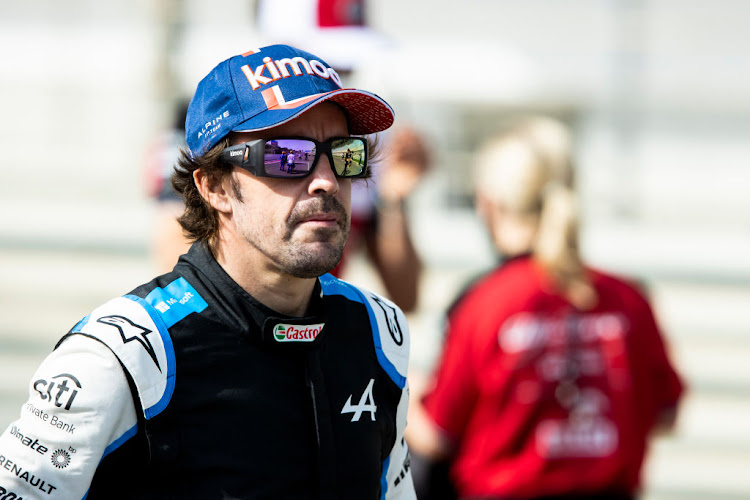 Fernando Alonso of Spain and Alpine F1 Team looks on from the grid during Day One of F1 Testing at Bahrain International Circuit on March 12, 2021 in Bahrain, Bahrain.