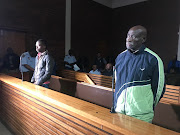 Ernest Mabaso, seen left, and co-accused Fita Khupe were facing of seven counts of murder and theft after they allegedly killed members of the Khoza family in Vlakfontein.