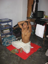 Photo: Sri Bandhu Smaran Brahmachari in Dhaka Mahaprakash Math in his morning rituals