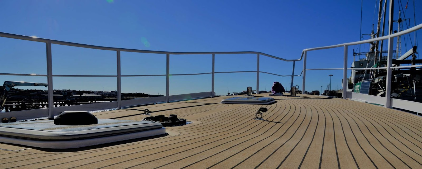 Sunbleached decking on a steel cutter rigger ketch motor sailer