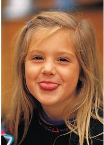 Little girl sticking tongue out and smiling