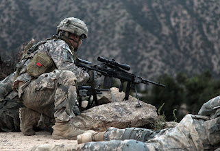 Photo: U.S. Army Soldiers of 1-102 Infantry, 86th Brigade Combat Team, Task Force Iron Gray provide over watch security in Masamute Valley as they prepare to cordon and search the village of Bala in Laghman province, Afghanistan, Sept. 25.