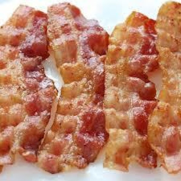 Preheat oven to 400^.In a skillet cook bacon until crisp. Drain; reserve 1 Tablespoon...
