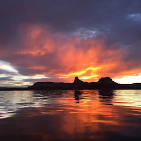 Fire in the Sky by Michelle Bergeson - Landscapes Waterscapes ( clouds, water, orange, sunset, horizon,  )