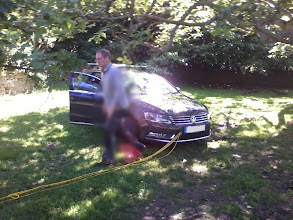 Photo: Someone parked his car in a boggy orchard where it got stuck. Silly man. But my brilliant dad pulled it out for him. I have pixelated the man's picture so no-one will be able to tease him about it.