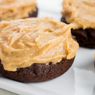 Fudgy Milk Chocolate Donuts With Peanut Butter Frosting.