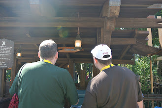 Photo: Abominations spy a sign in Adventureland while solving the Tree Climbing quest.