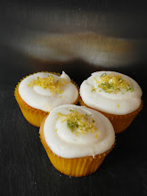 Photo: Lemon and lime cupcakes topped with lemon and lime infused cream cheese icing topped with lemon and lime rind.