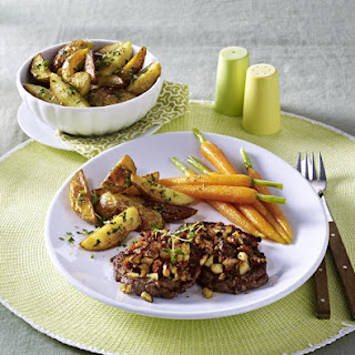Nut Crusted Steaks With Potato Wedges.