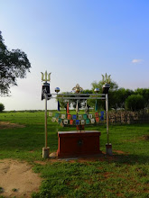 Photo: Namka told me that every family in her area has a shrine like this. The two poles are Genghis Khaan's battle standard. Much of the country practices Buddhism in addition to shamanism, so family shrines also have prayer flags.