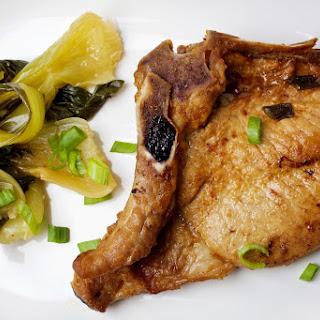 Asian-Marinated Pork Chops With Bok Choy. (Deb Lindsey/For The Washington Post).