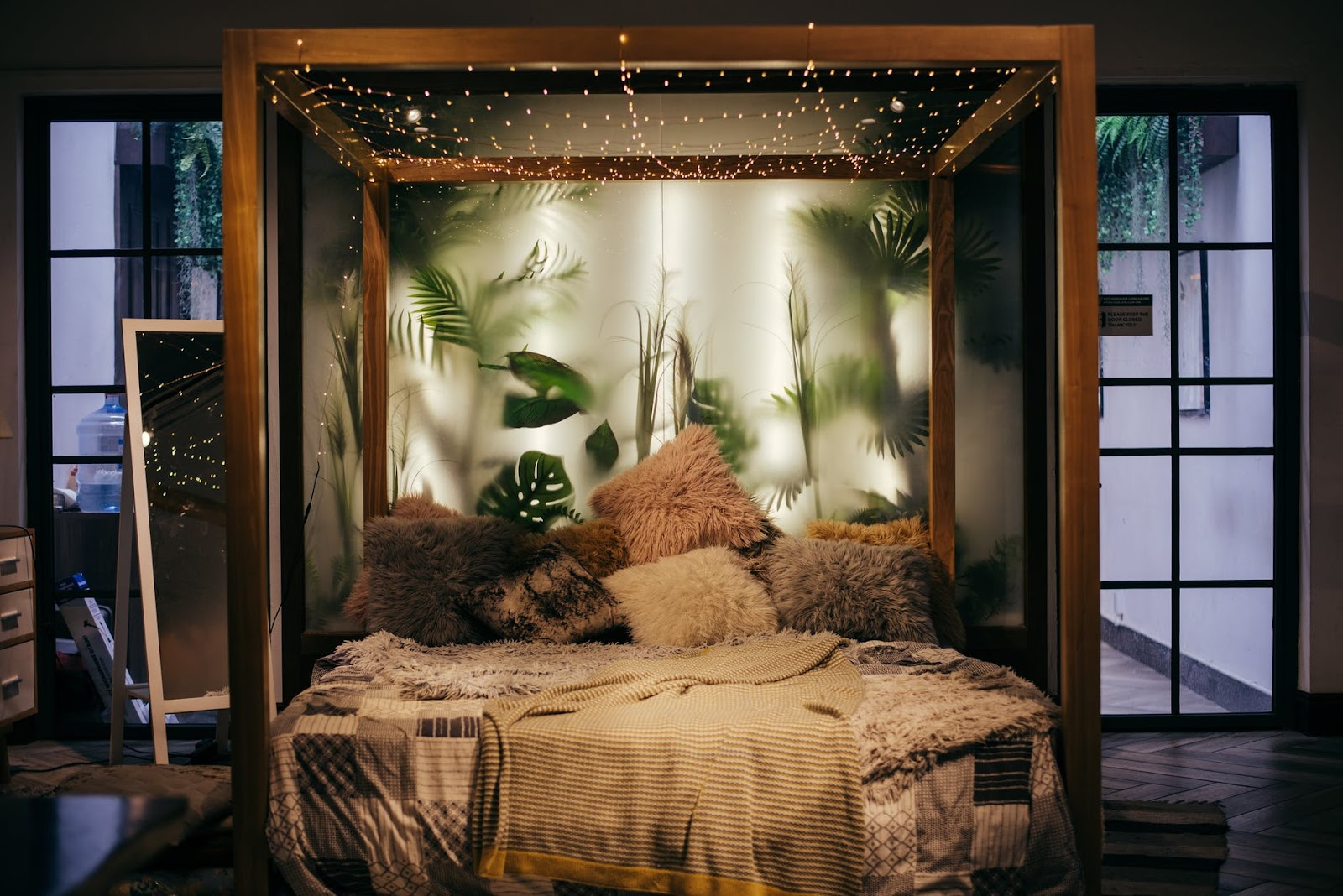 boho bedroom with twinkle lights and plants