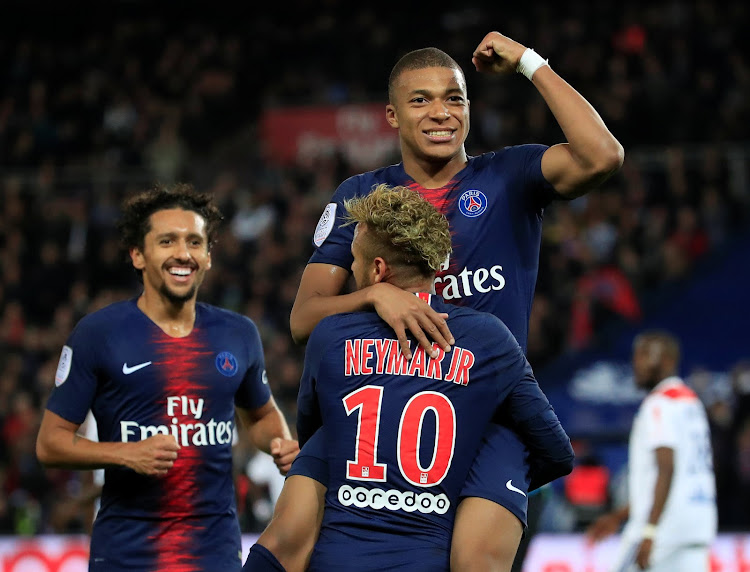 Paris St Germain's Kylian Mbappe celebrates scoring their fifth goal with Neymar during a 5-0 Ligue 1 crushing win over Olympique Lyonnais at the Parc des Princes in Paris, France, on October 7, 2018.