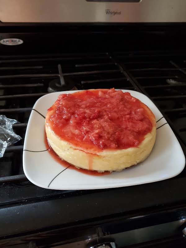 Low Carb Cheese Cake Topped With Fresh Strawberry Sauce