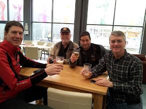 Photo: Lee, Bob, Dan and Hamp enjoy a half pint in the Thornbridge visitors center.