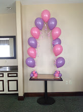 Photo: tabletop string of pearls arch with streamers
