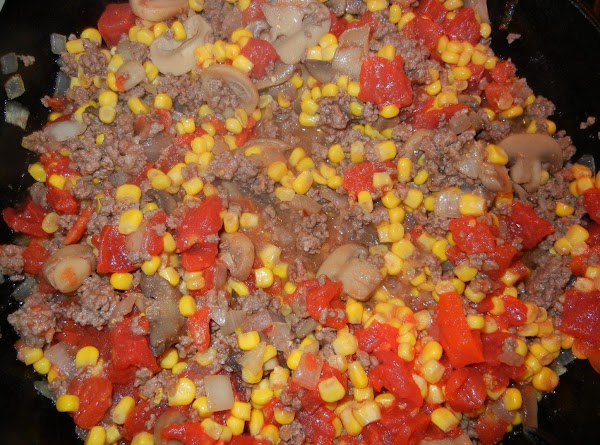 Add veggies and can of diced tomatoes to meat mixture.