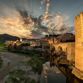 Golden moments of Besalú by Torsten Funke - City,  Street & Park  Vistas ( clouds, cloudscape, villages, cityscape, landscape, sun, spain, riverside, village, sunset, sunsets, sunrays, sunshine, river, catalunya,  )