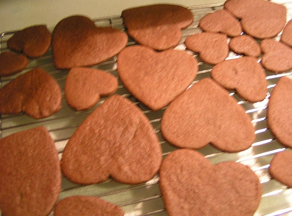 Photo of baked cookies cooling on rack.