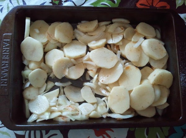 Roughly dice and slice up the potatoes and onion.  Place in baking dish...