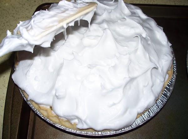 Using your spatula or spoon tap the top of the meringue to lift up...