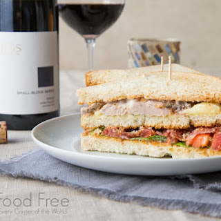 Club Sandwich with Duck Breast, Cambozola, Applewood Smoked Bacon and Roasted Garlic Spread.