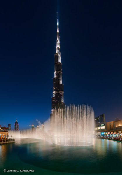 Photo: The mega-fountains of Dubai Mall, with Burj Khalifa on the background. Vertical panorama, digital blending. Quite a technical shot to do: The buildings were shot at ISO 200 f/5.6 (3 exposures: 1, 2, 4 sec shutter speed) The fountains were shot at ISO 800 f/2.8 1/200 sec shutter speed and added to the building shot.