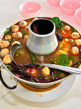 Photo: very spicy hot-and-sour mixed seafood soup with straw mushrooms