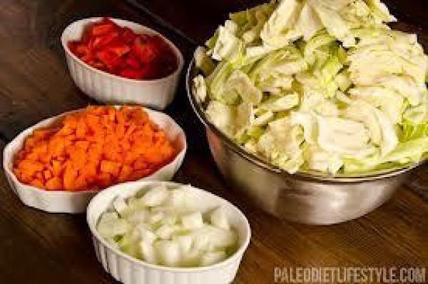 Add potatoes, onion, carrots and cabbage to boiling water.  (parboil the cabbage separately...