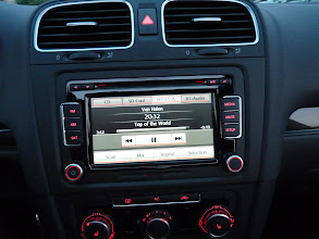 Photo: Touch screen radio AM/FM, Sirius, SD Card, Aux Input, Ipod Control, 6 CD Changer w/mp3, Bluetooth audio