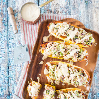White Bean & Brussels Sprout Stuffed Delicata Squash with Lemon Tahini Sauce
