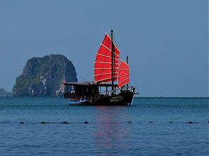 Photo: boat with red sails in front of Phranang beach