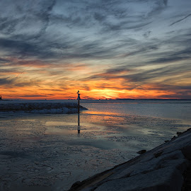 Sunset Over The Bay by Carol Ward - Landscapes Sunsets & Sunrises ( winter, waterscape, ice, sunset, frozen waterway, maryland, chesapeake bay, stevensville, landscape, waterway )