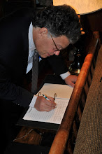 Photo: United States Senator Al Franken, the Great State of Minnesota, signs the guest book in Valhalla that includes such people as the Governor of Minnesota.  Senator Franken made his trip to Camp Ripley to gain a better understanding of all things the facility has to offer for training the Guard and the various civilian agency partners Camp Ripley has. (photo by 1st Lt. Kenneth R. Toole, Camp Ripley Public Affairs Officer)