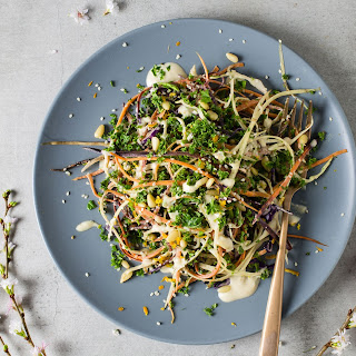 Healthy Kale And Carrot Slaw With Clementine Tahini Sauce.