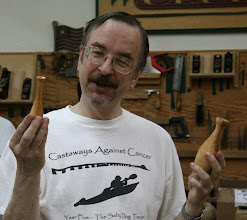 Photo: Gary Guenther with two weed pots -- the first two pieces he ever turned, years ago.