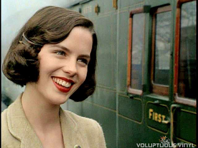 Kate Beckinsale smiles outside train depot in Haunted.