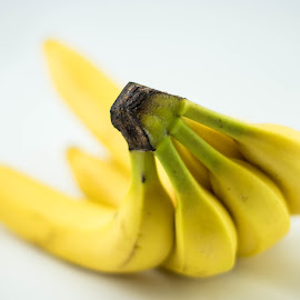 Bunch of Bananas by Helen Nickisson - Food & Drink Fruits & Vegetables ( white, yellow, white background, bananas, bunch )