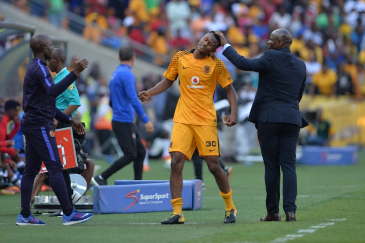 Kaizer Chiefs' teenage right-back Siyabonga Ngezana shares a light moment with head coach Steve Komphela during the Absa Premiership match against Orlando Pirates at FNB Stadium on October 21, 2017 in Johannesburg, South Africa.