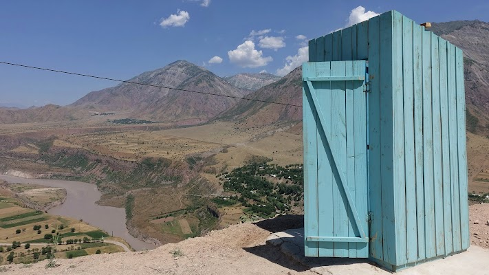 Wooden toilet house at the Pamir-Highway.
