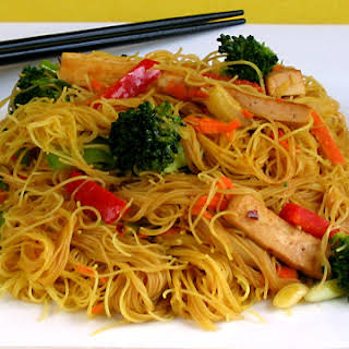 Singapore-Style Rice Noodles with Tofu and Vegetables.