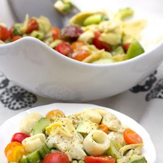 Hearts of Palm Salad with Artichoke Hearts, Cucumber, Tomato, Avocado.