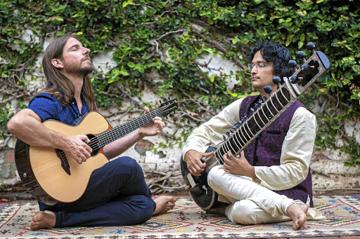 Meeting of minds: Standard Bank Young Artists Award winner for music Guy Buttery meditates musically with Indian sitar player and classical vocalist Kanada Narahari. The two will present a collaborative show titled The Mending at the National Arts Festival. Picture: SUPPLIED