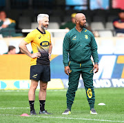 The Springboks assistant coach Mzwandile Stick (R) watches on during the national rugby team's training session on September 5 2018 in Brisbane alongside head of athletic performance Aled Walters (L)  ahead of South Africa's third Rugby Championship match against Australia on September 8 2018.