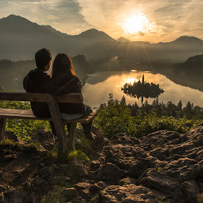 A couple at the Sunrise & Lake in Mountains by Aleš Krivec - People Couples ( water, reflection, europe, church, beautiful, white, forest, lake, architecture, reflecting, island, mountains, winter, tree, nature, fog, bled, castle, mist )