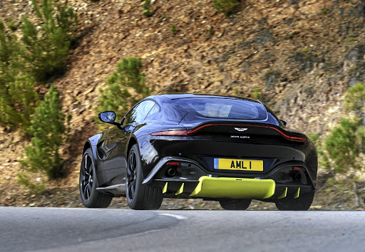 The rear is a combination of elegant lines and that aggressive diffuser, which can be more subtle in other colours. Picture: ASTON MARTIN