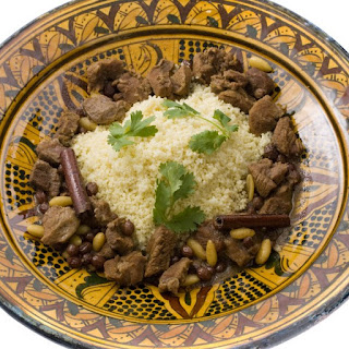 Moroccan Lamb Tagine with Raisins, Almonds, and Honey.