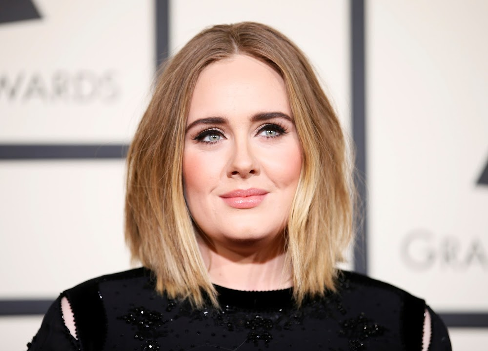 Pop singer Adele parts with husband, commits to partnership to raise son