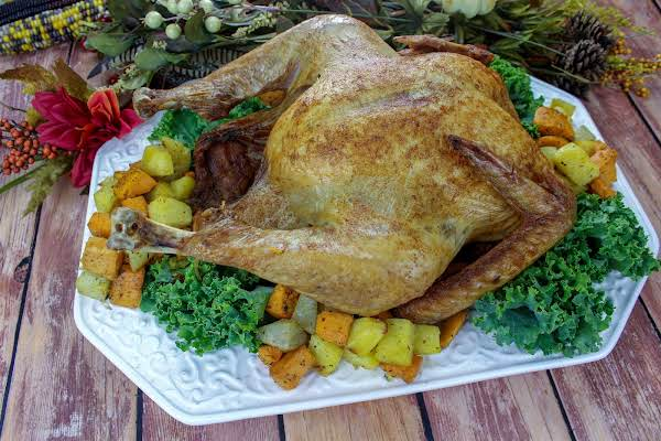 Deep-fried Turkey On A Platter With Roasted Potatoes.